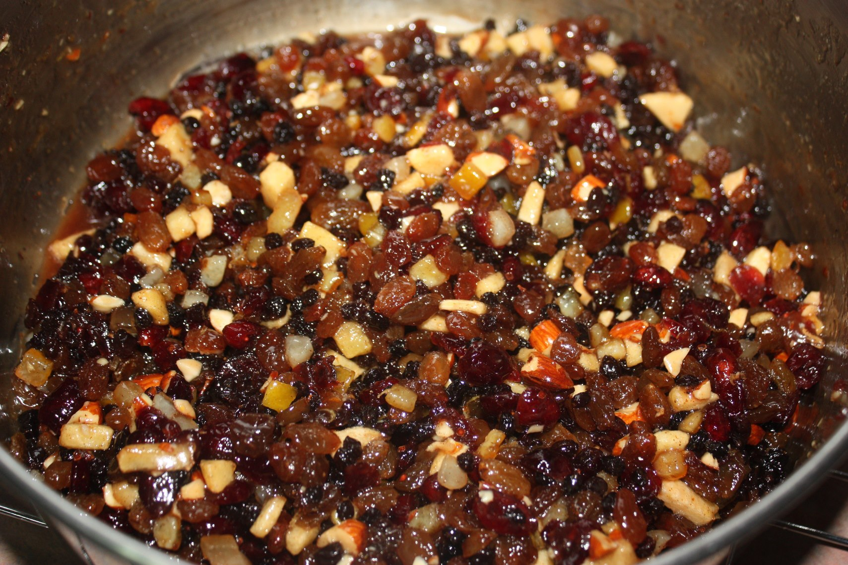 Homemade mincemeat simmering on a stovetop